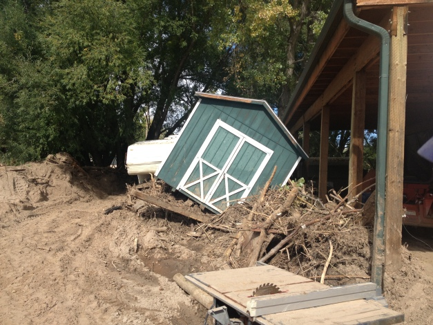 The flood turned this shed on its side!